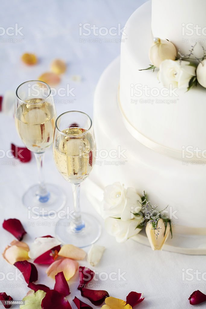Champagne Flutes And Wedding Cake On Table At Reception royalty-free stock photo