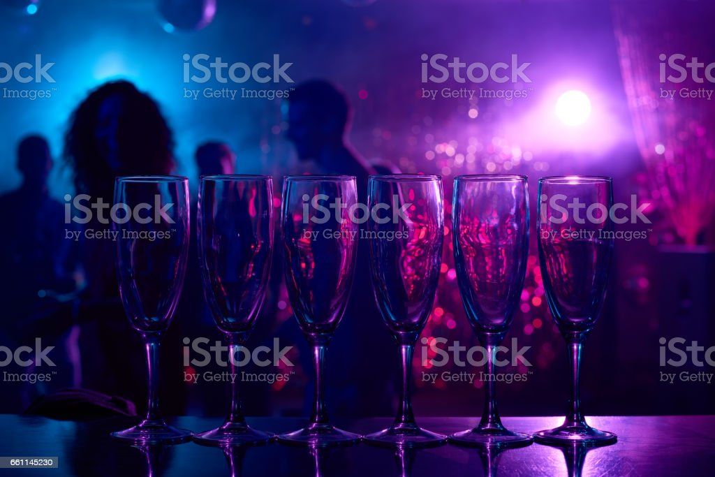 Champagne flutes on bar counter stock photo