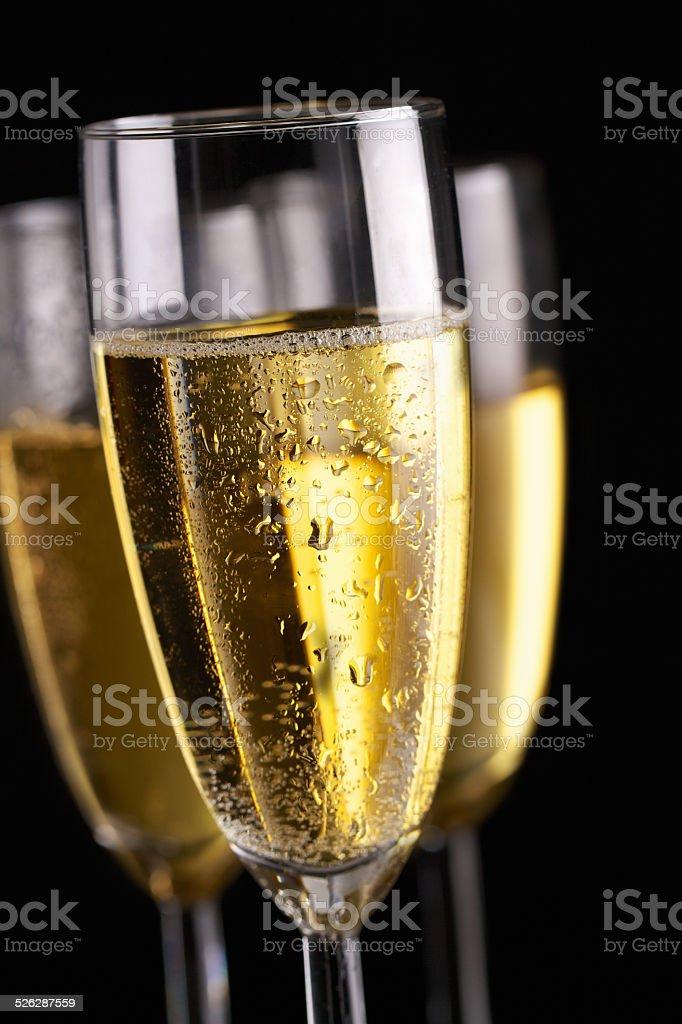 Champagne flutes on black stock photo