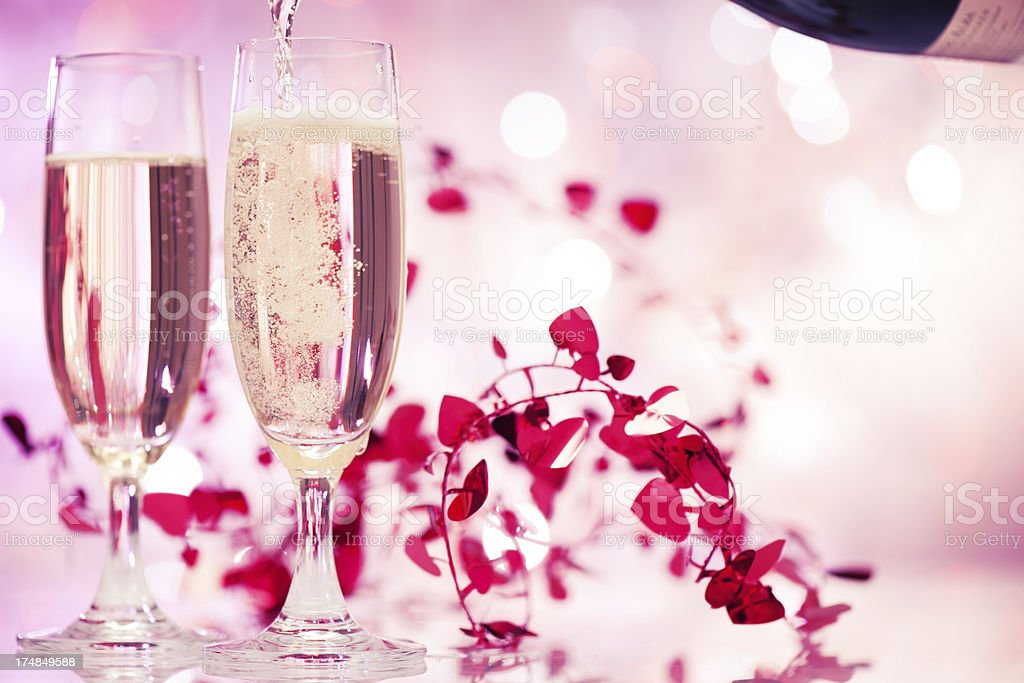 Champagne flutes on illuminated background stock photo