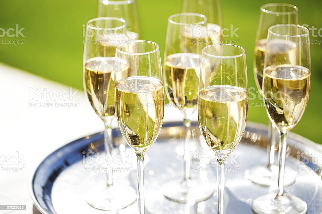 Champagne Flutes On Serving Tray At Table royalty-free stock photo
