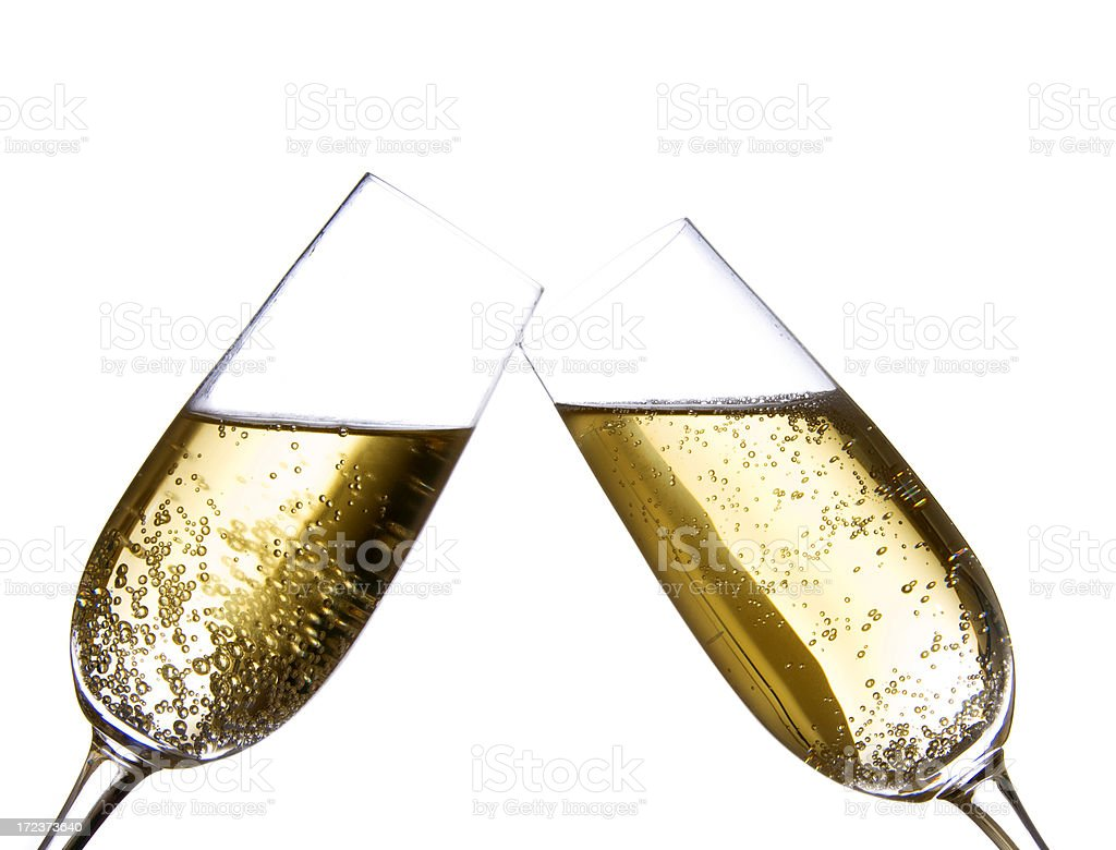 champagne flutes touching royalty-free stock photo