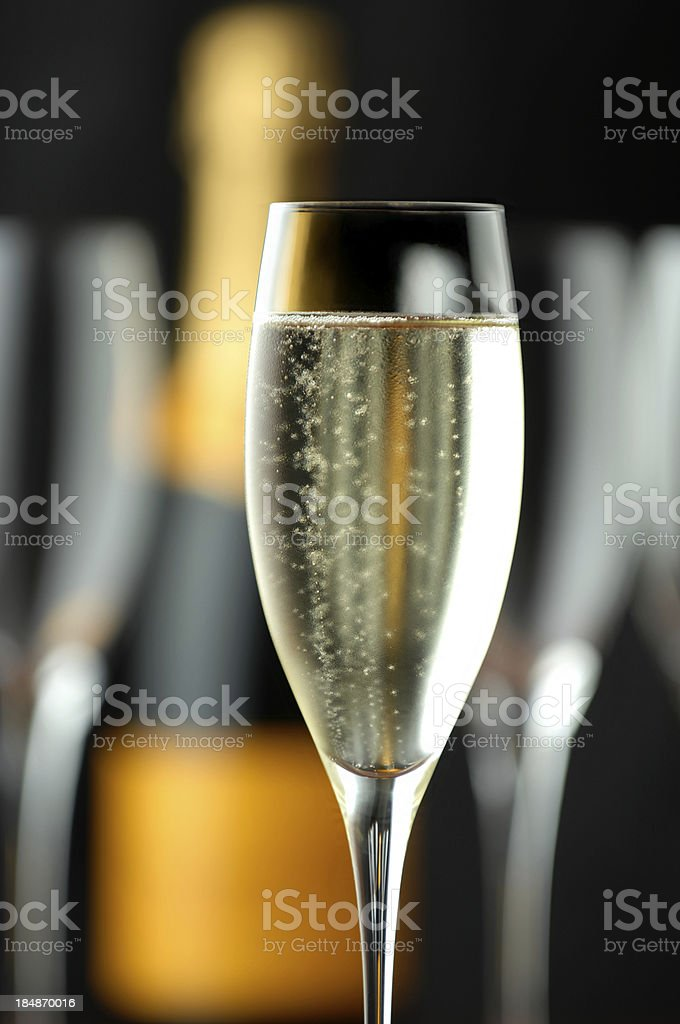 Champagne Flutes with Bottle on Black royalty-free stock photo