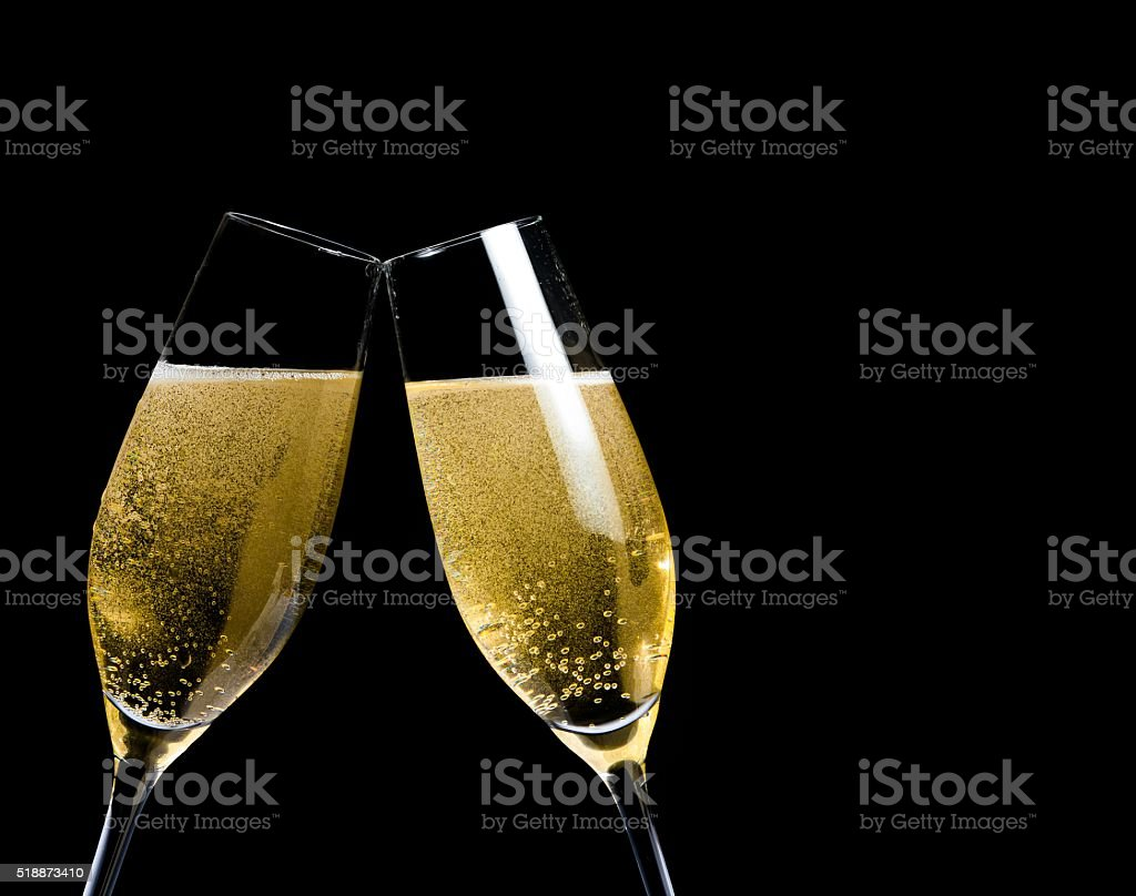 champagne flutes with golden bubbles make cheers stock photo