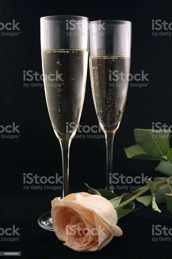 Champagne Flutes With Peach Rose royalty-free stock photo