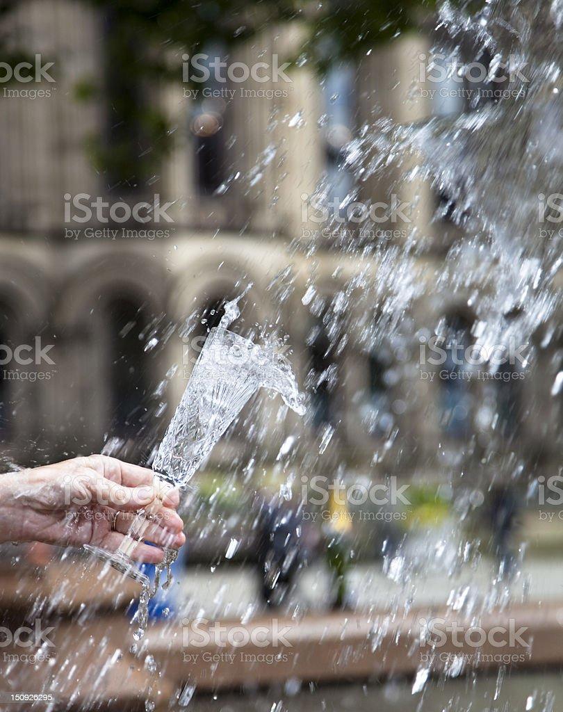 Champagne glass in fountain stock photo