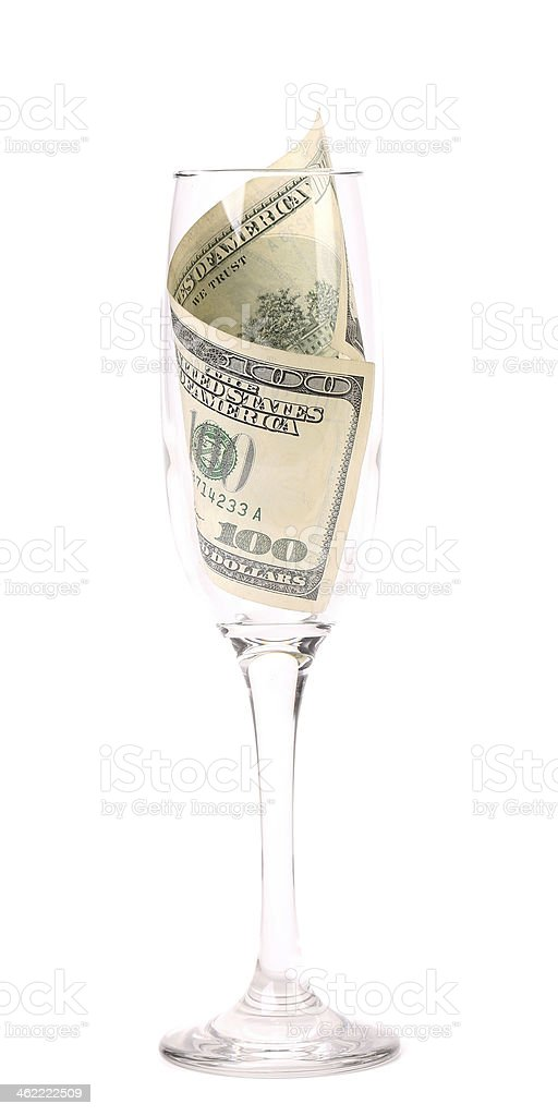 Champagne glass with money. stock photo