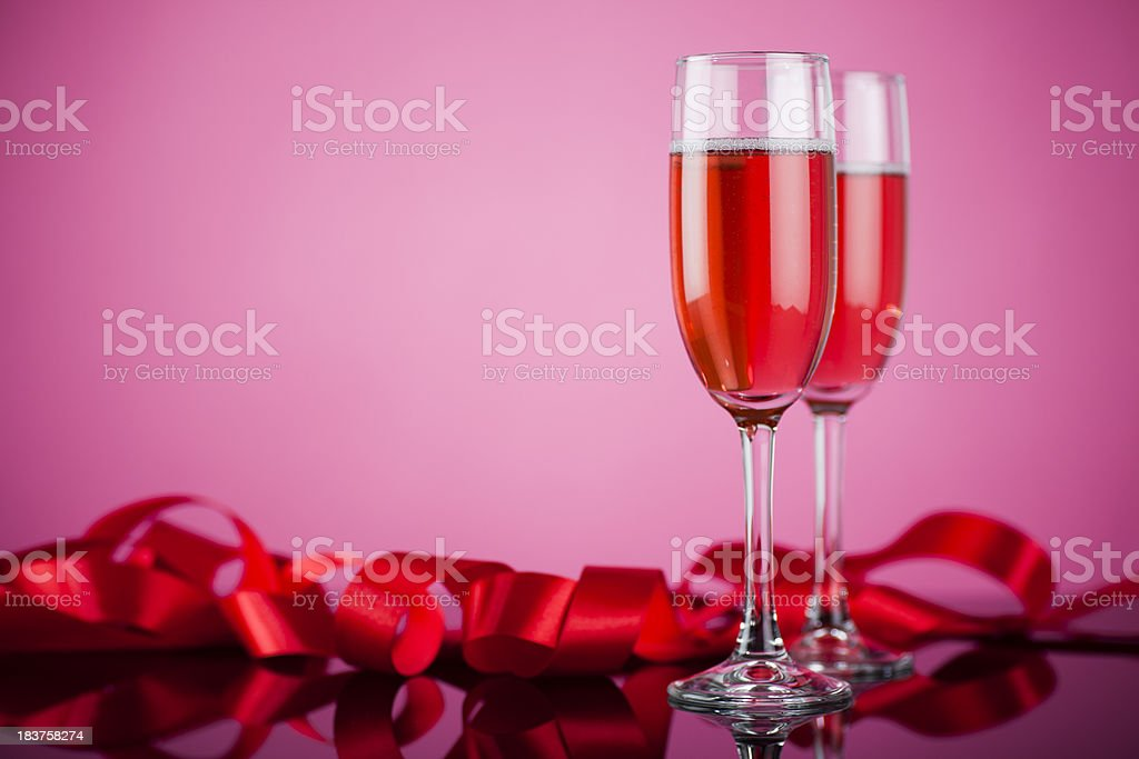 Champagne glass with rose sparkling wine stock photo