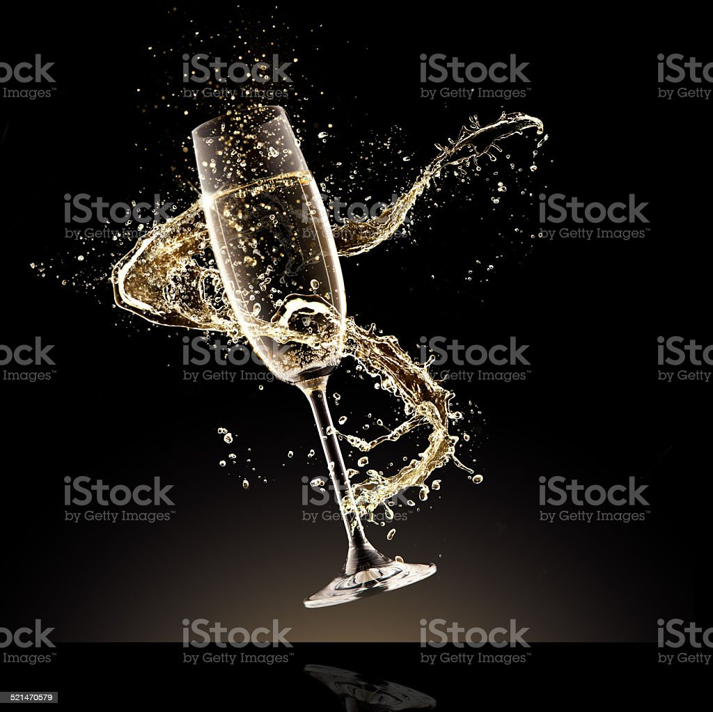 Champagne glass with splash stock photo