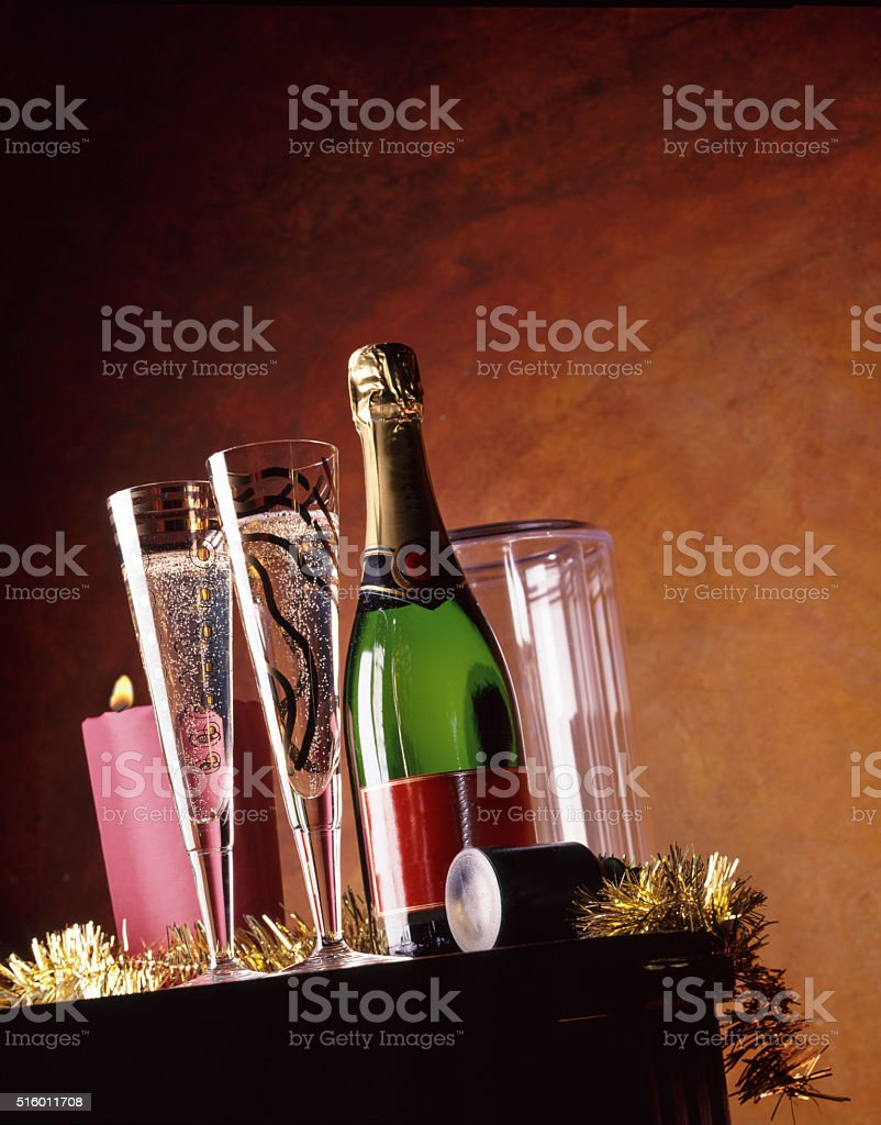 champagne glasses and bottle on table stock photo