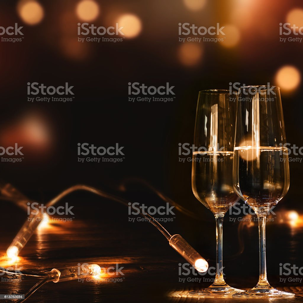 Champagne glasses in front of a festive background stock photo