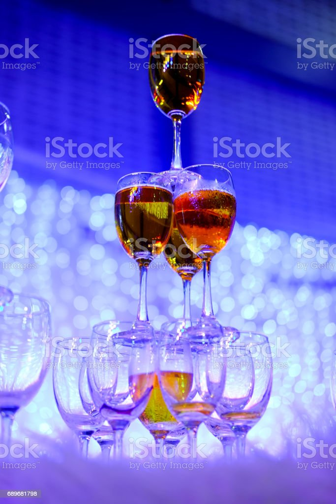 Champagne glasses in wedding ceremony. Tower of champagne glasses stock photo