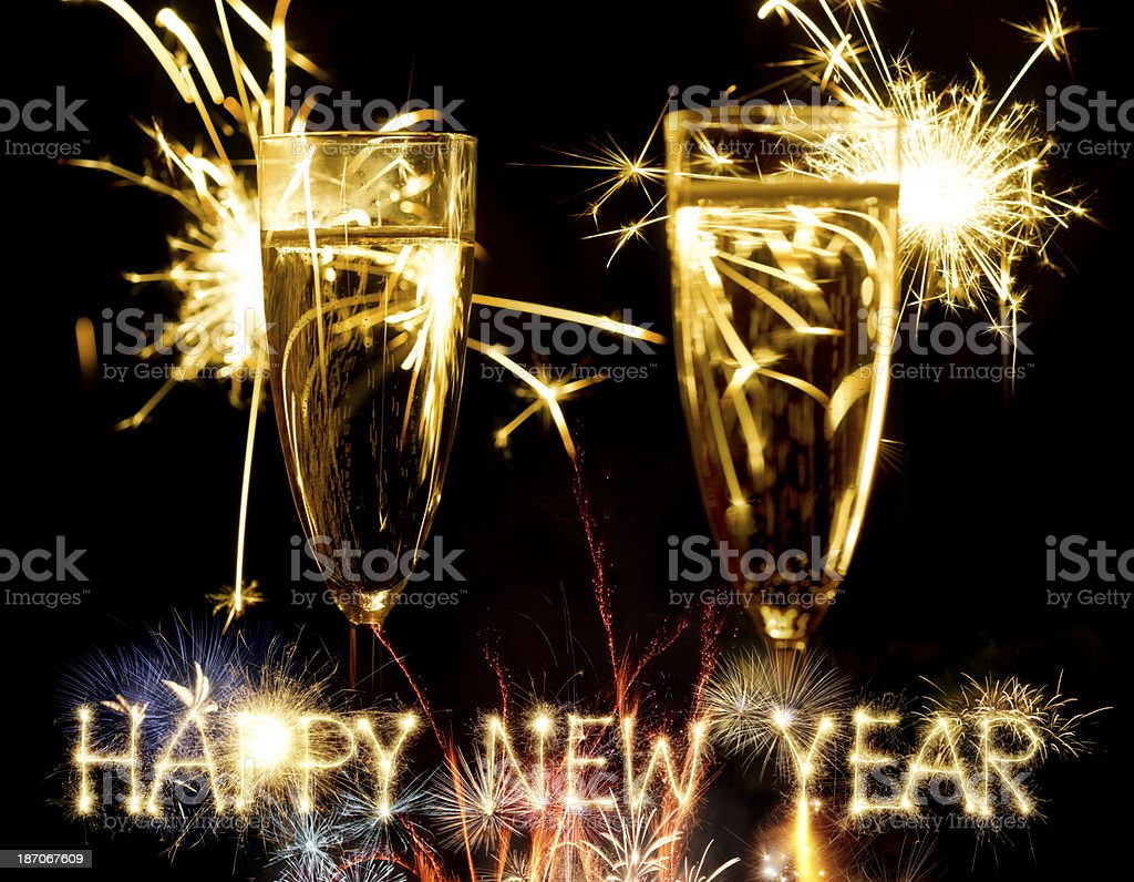 Champagne Glasses Infront Of Fireworks And Sparkling Happy New Year royalty-free stock photo