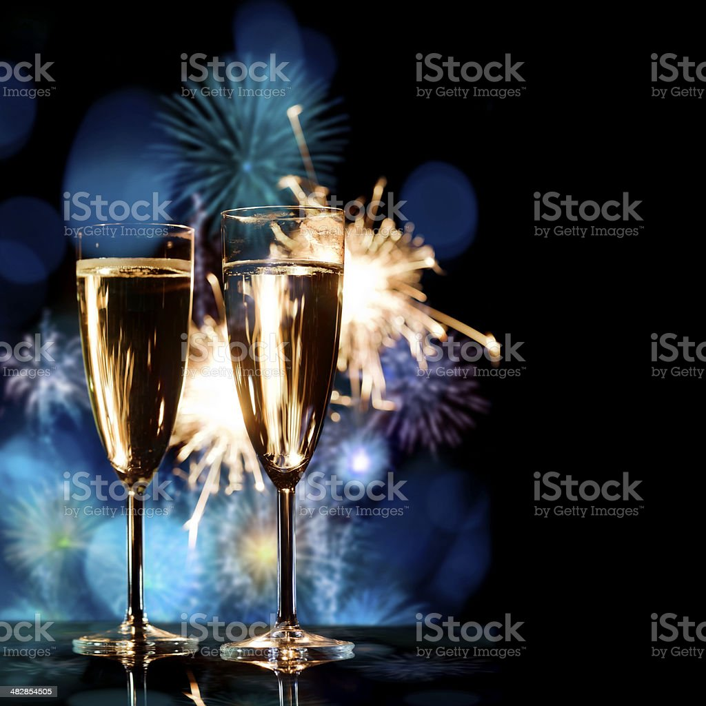 Champagne Glasses Infront Of Fireworks – New Year 2016 stock photo
