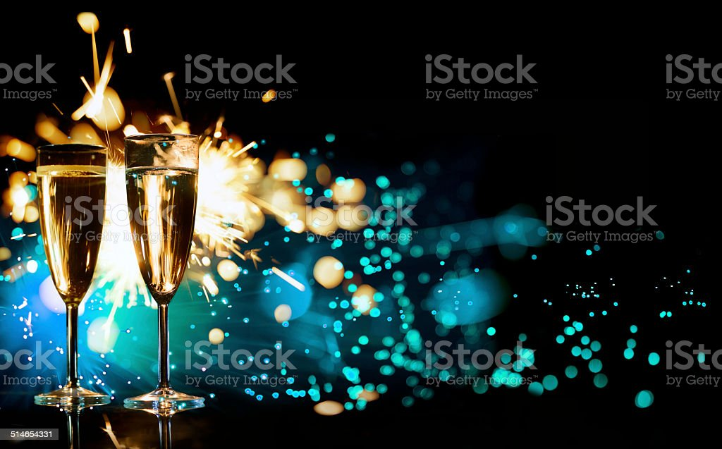 Champagne Glasses Infront Of Fireworks – New Year 2014 stock photo