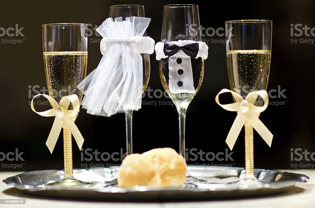 Champagne glasses made as bride and groom royalty-free stock photo