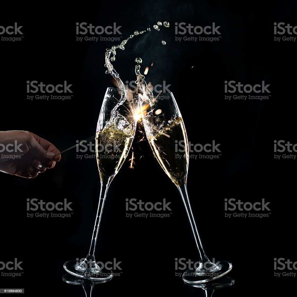 Champagne Glasses On Black Background With Sparkler stock photo