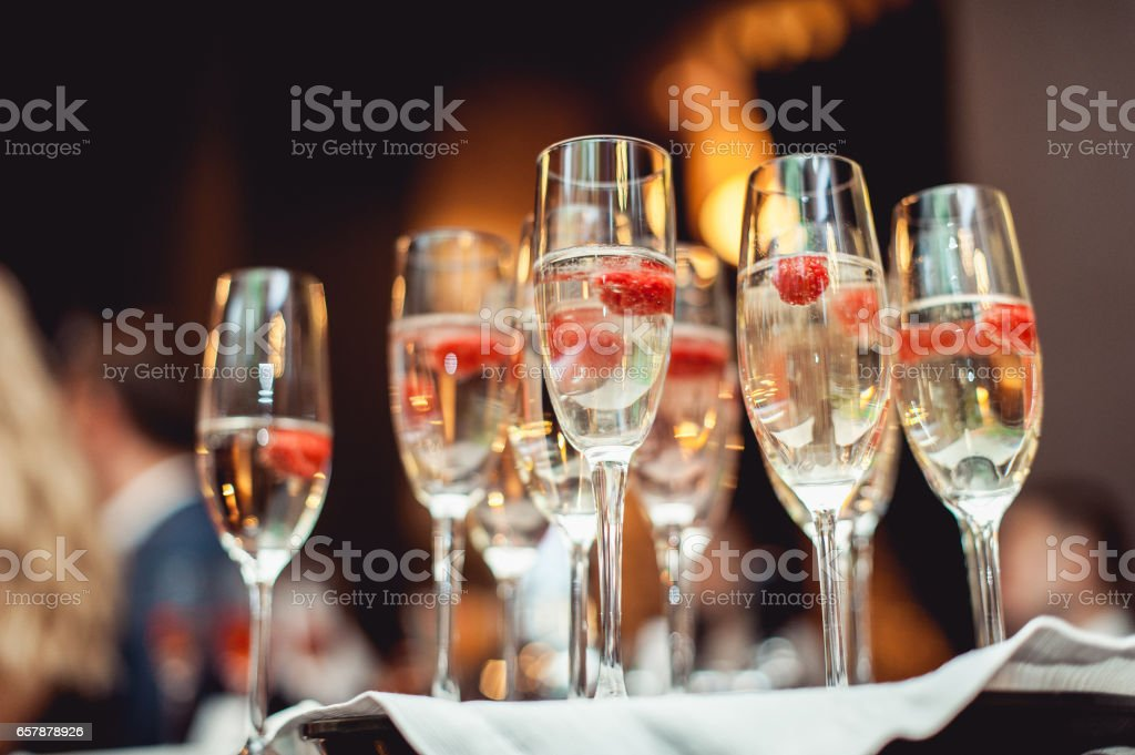 champagne glasses wich raspberries stock photo