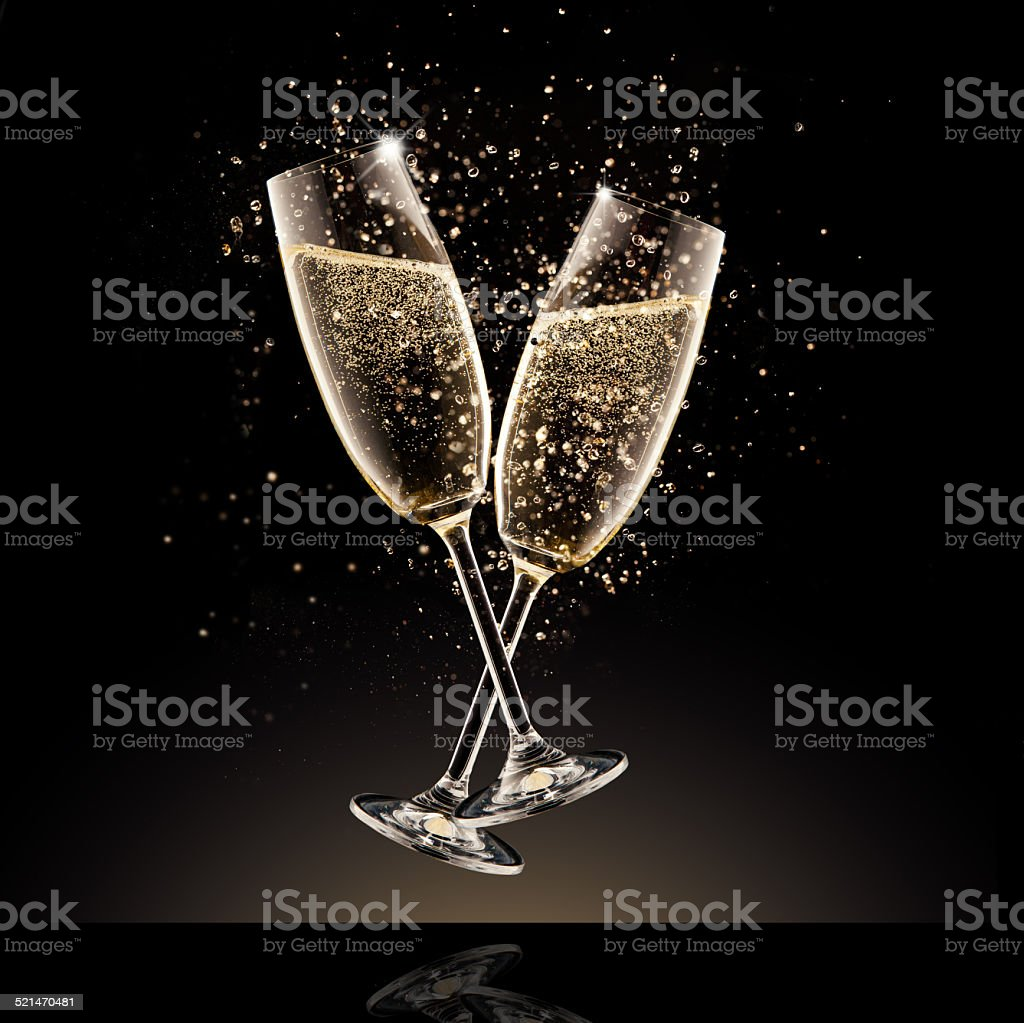 Champagne glasses with bubbles stock photo