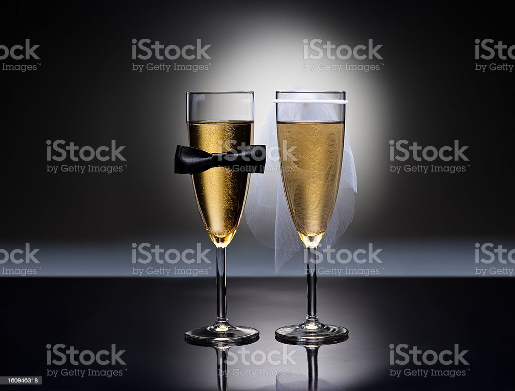 Champagne glasses with conceptual heterosexual decoration royalty-free stock photo