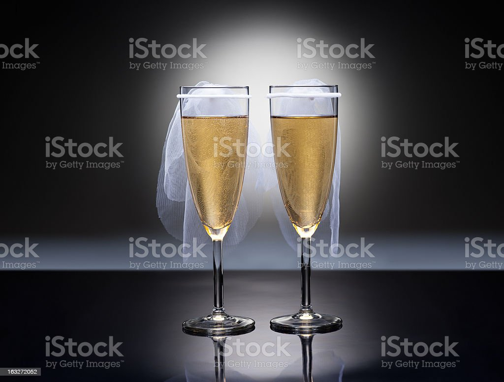 Champagne glasses with conceptual same sex decoration royalty-free stock photo