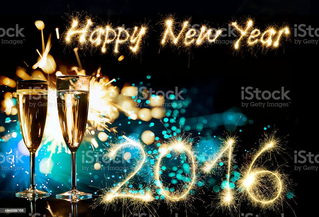Champagne Glasses With Sparkler Happy New Year 2016 stock photo
