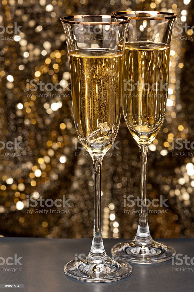 Champagne glasses with submerged ring royalty-free stock photo