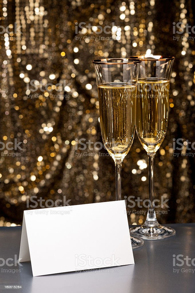 Champagne glasses with white card stock photo