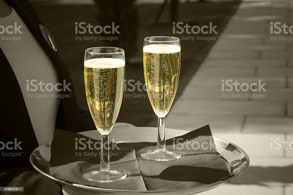 champagne in glasses being served at a wedding royalty-free stock photo
