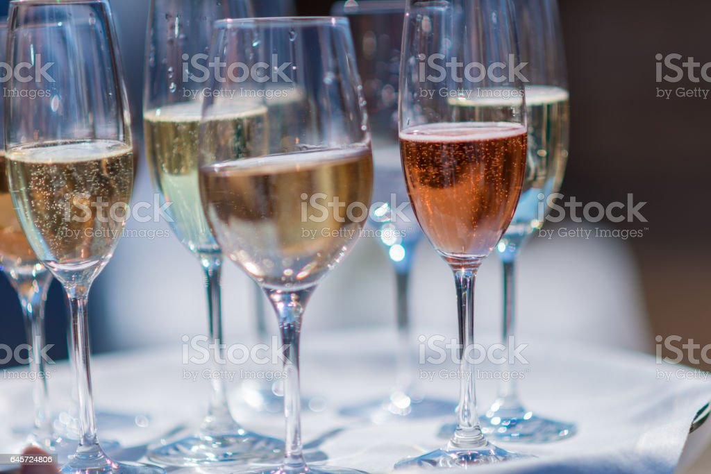 Champagne in glasses on salver with napkin stock photo