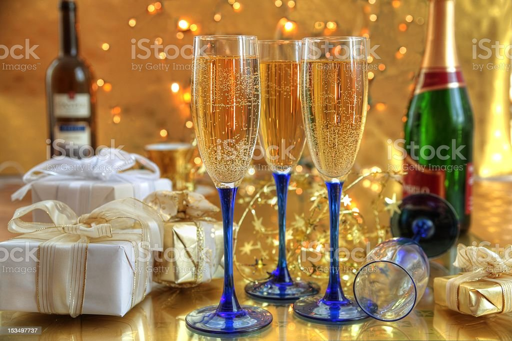 Champagne in glasses,gift boxes and twinkle lights. royalty-free stock photo