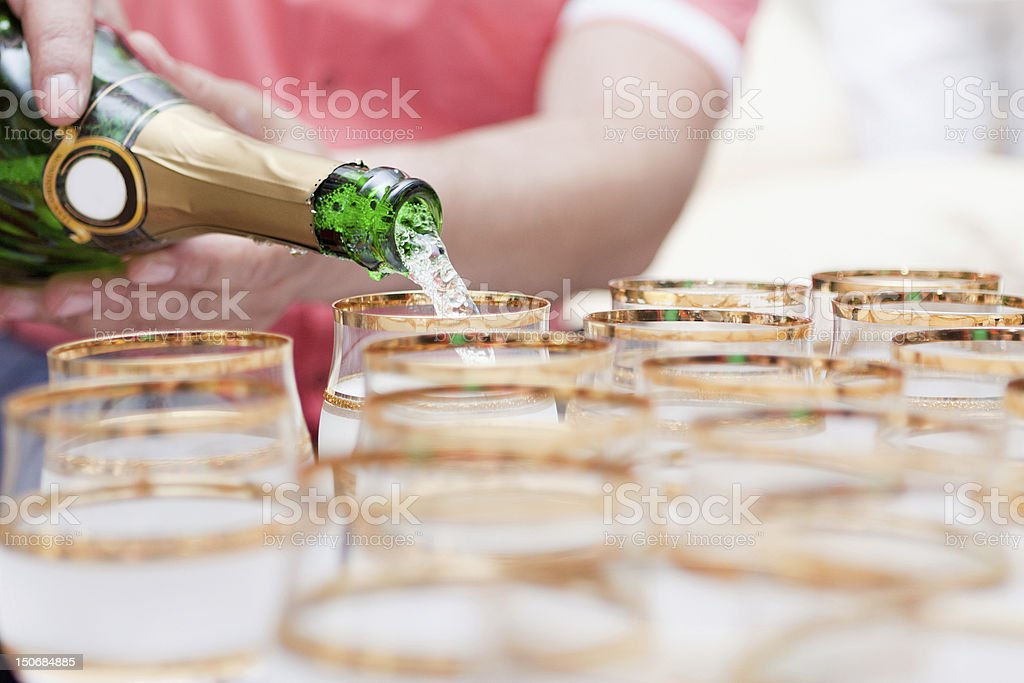 champagne pour into glasses royalty-free stock photo
