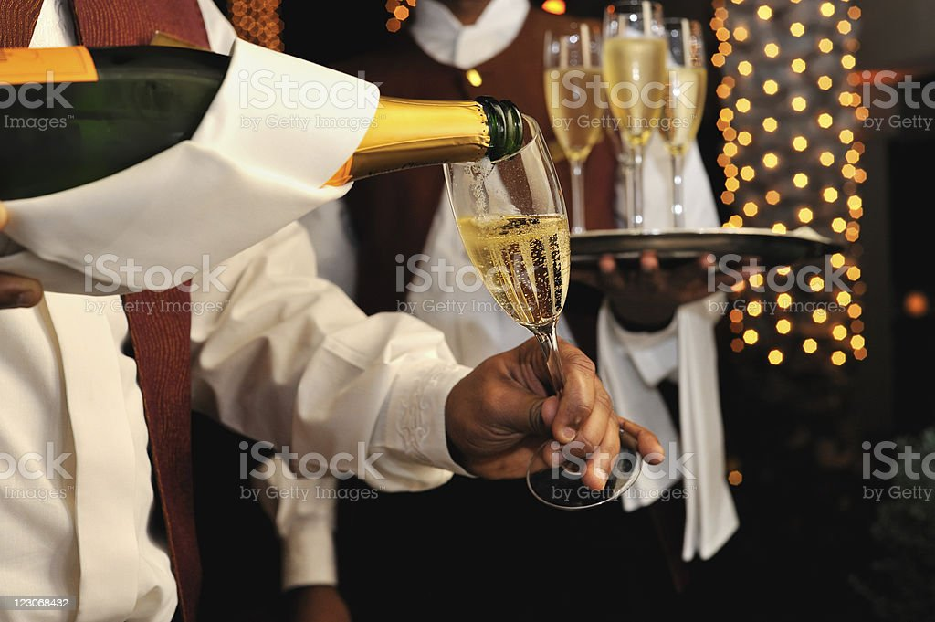 champagne pouring stock photo