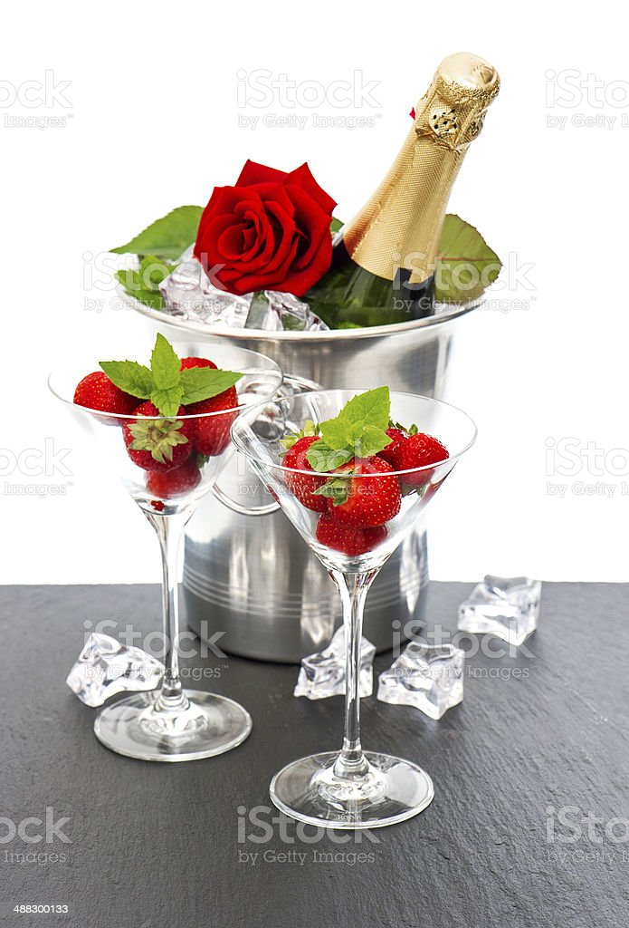 champagne, red rose and strawberries over white royalty-free stock photo