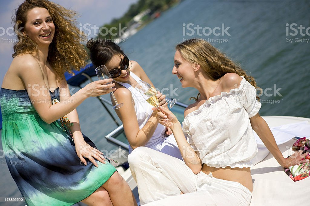 Champagne toast on boat royalty-free stock photo