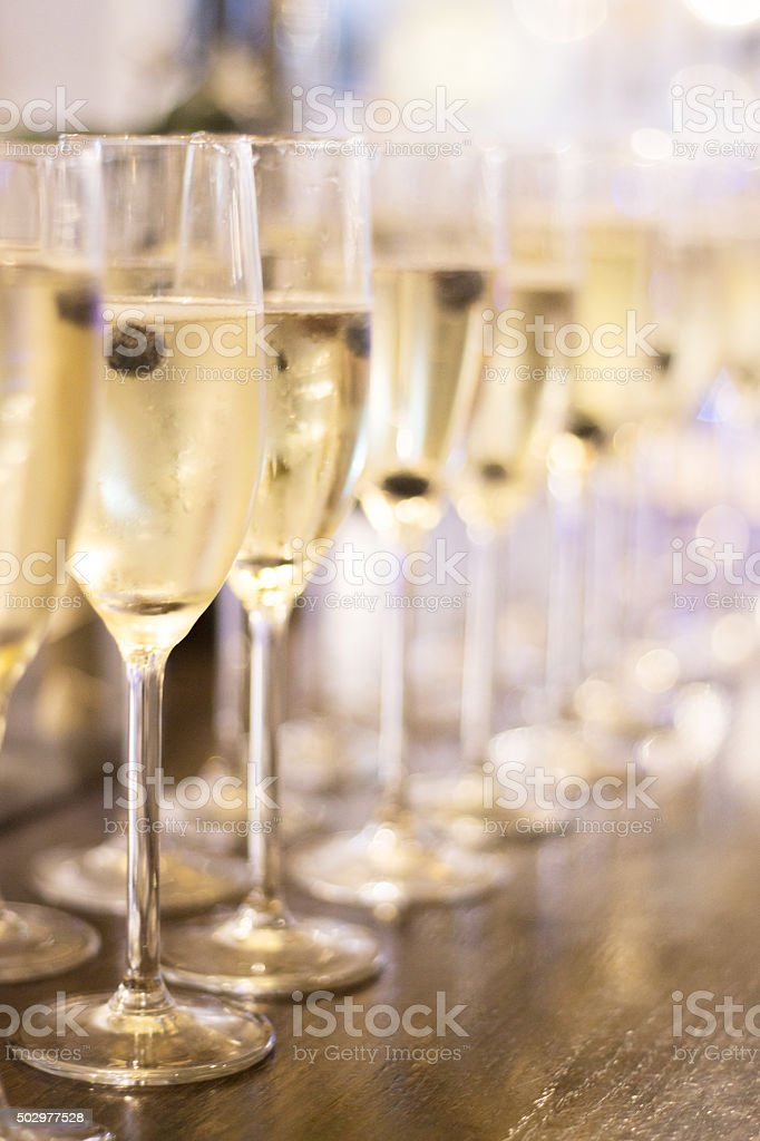 Champagne white wine glasses in wedding party stock photo