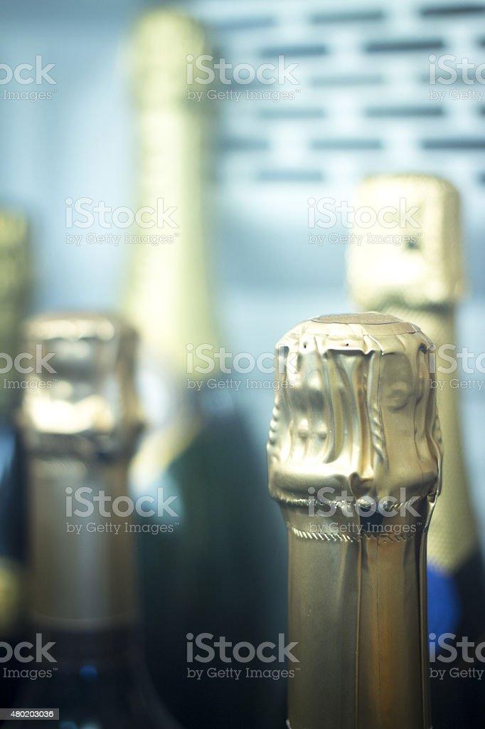 Champagne wine bottles rack fridge cooler stock photo