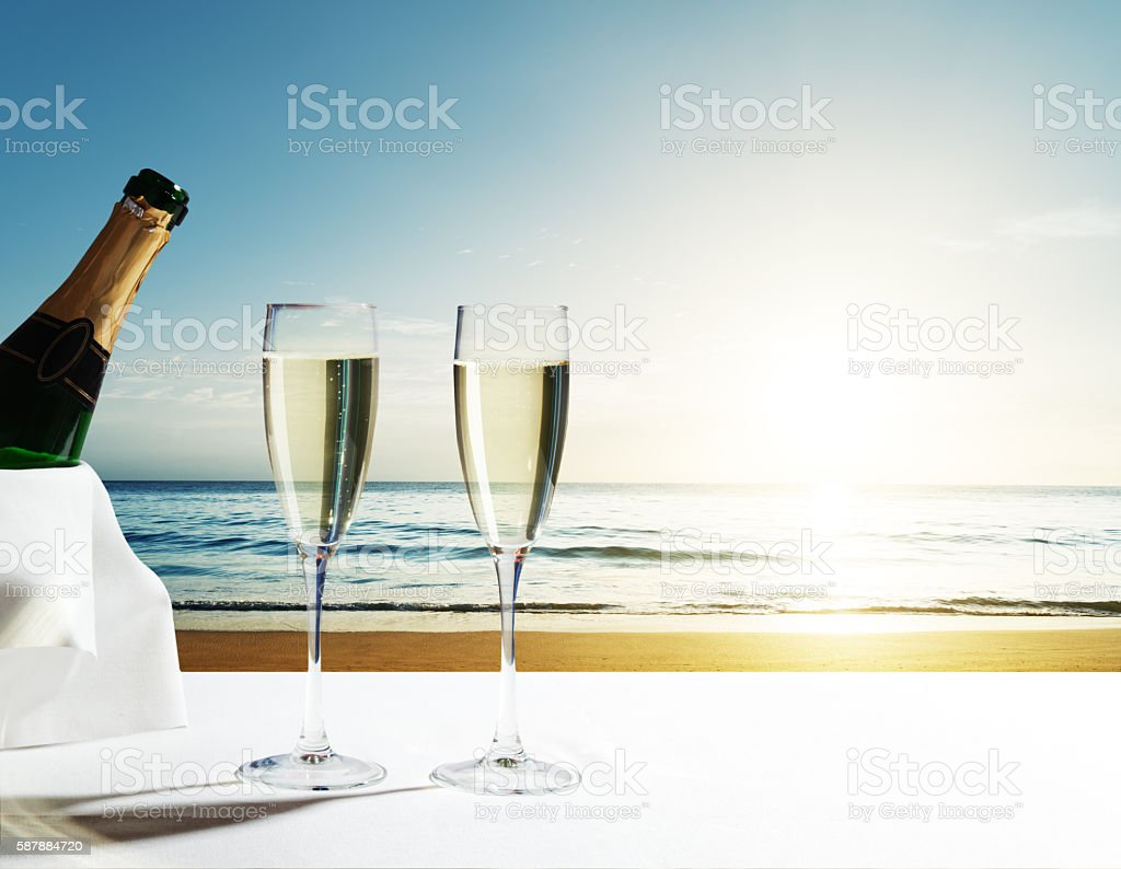 champaign Glasses and sunset on Seychelles beach stock photo