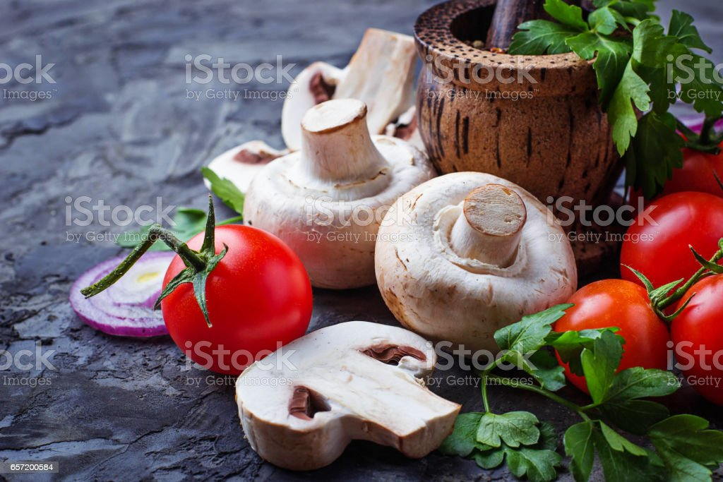 Champignon mushrooms, cherry tomatoes and red onion stock photo