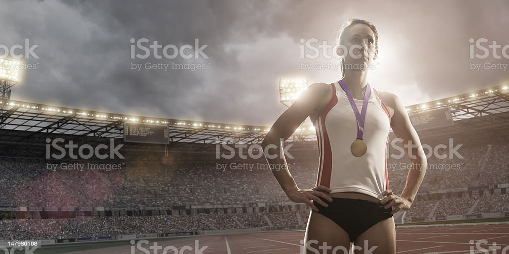 athlete wearing gold medal stock photo
