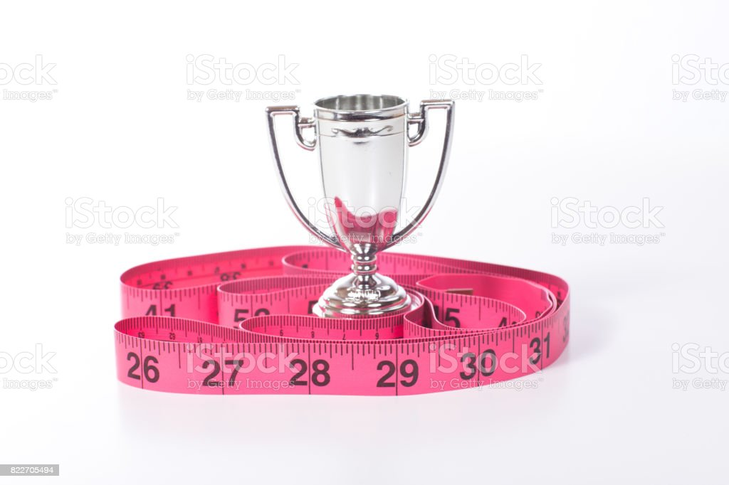 Champion cup and measuring tape stock photo