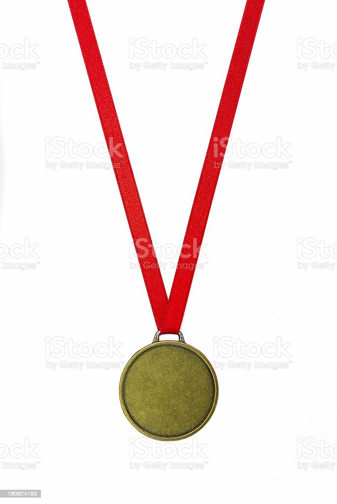 Champion medal on wood desk royalty-free stock photo