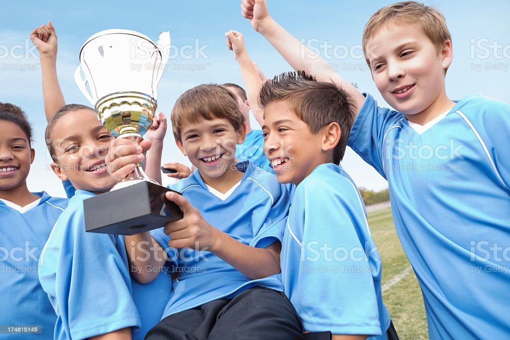 Champion youth soccer team with winning trophy! stock photo