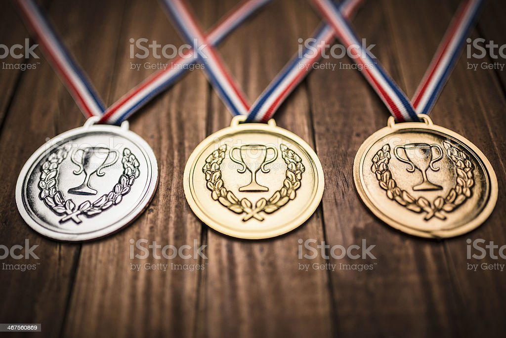 championship medals on plank wood stock photo