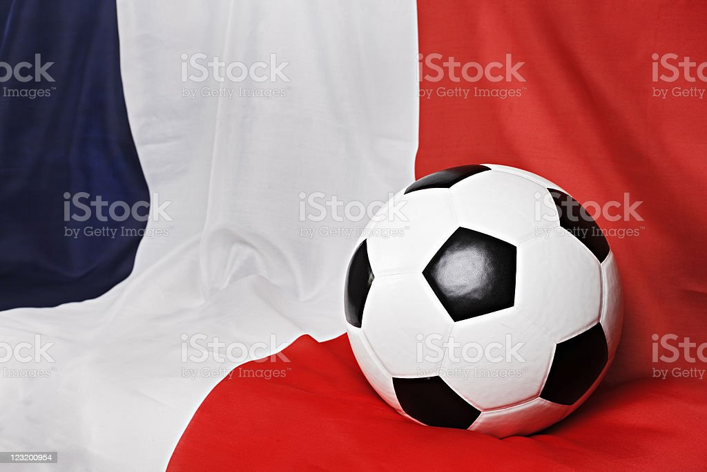 Championship soccer ball rests on draped French flag stock photo