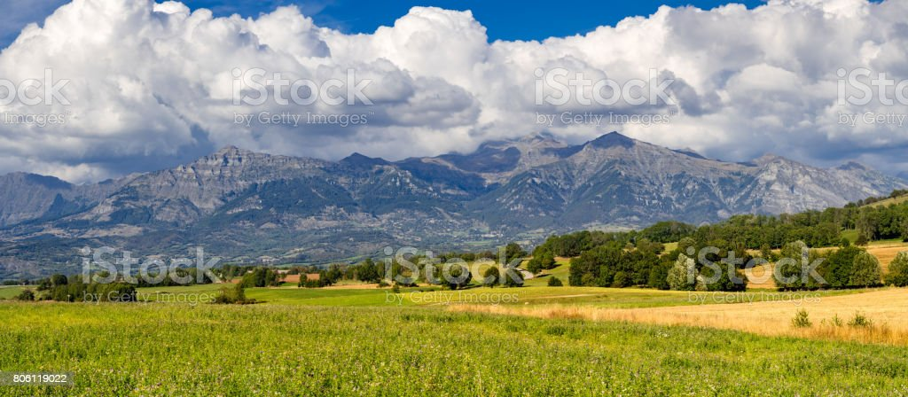 Champsaur Valley from the Manse Pass in summer (Panoramic). Hautes-Alpes, Alps, France stock photo