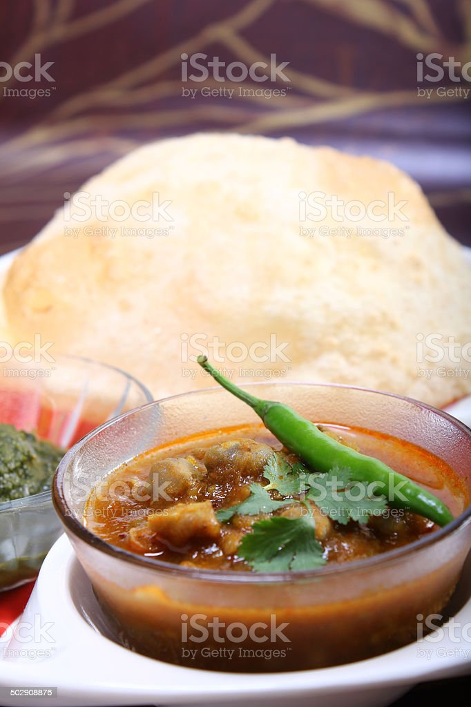 chana masala with bhature, indian spicy dish stock photo
