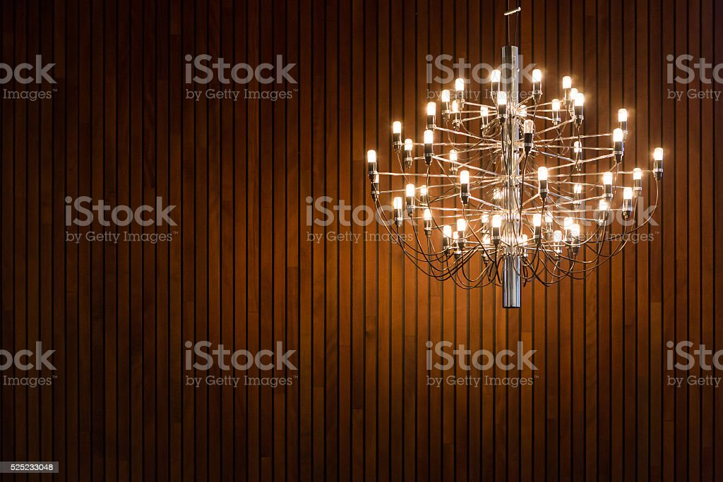 Chandelier on wooden background stock photo