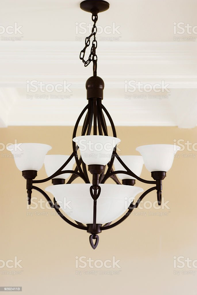 A chandelier pendant light hanging from a ceiling royalty-free stock photo