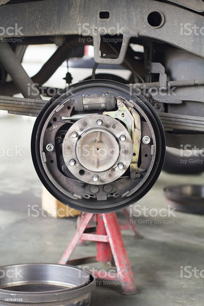 Change brake drum of suv car stock photo